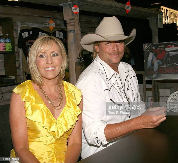 Best selling writer Denise Jackson and husband musician Alan Jackson pose during the 2008 CMA Music Festival at the Sommet Center June 6 2008 in...