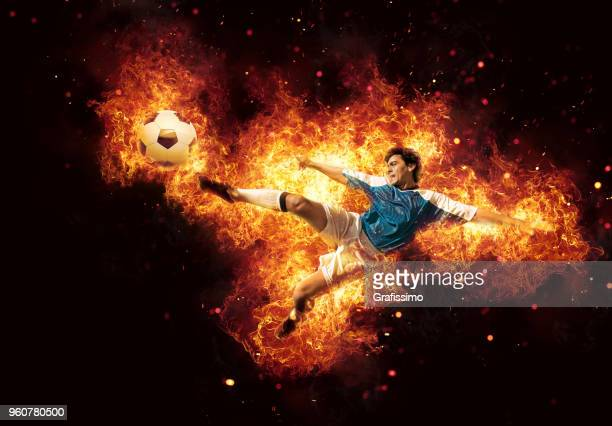 best soccer player kicking ball surrounded by fire and flames - scoring stock pictures, royalty-free photos & images