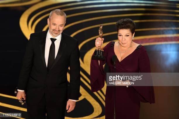 Best Sound Editing nominees for Bohemian Rhapsody John Warhurst and Nina Hartstone accepts the award for Best Sound Editing for during the 91st...