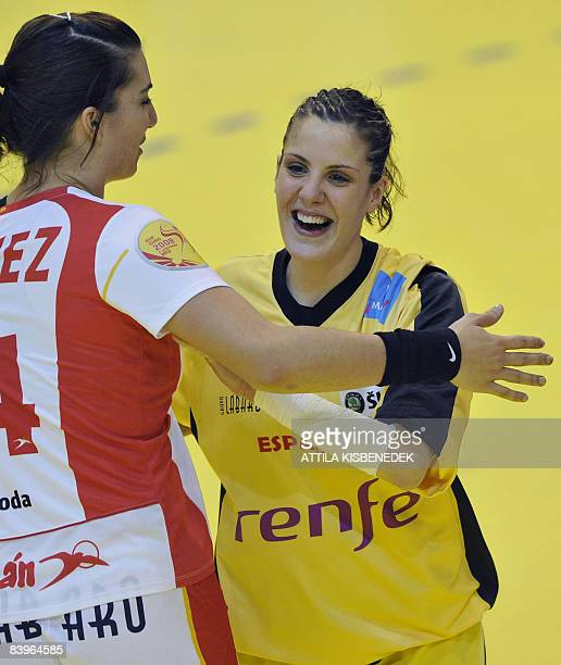 Best Spanish players of this match goalkeeper Cristina Gonzales celebrates their victory with her teammate Carmen Martin against Romania after the...