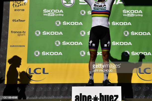 TOPSHOT Best sprinter Slovakia's Peter Sagan celebrates on the podium after the twelfth stage of the 105th edition of the Tour de France cycling race...