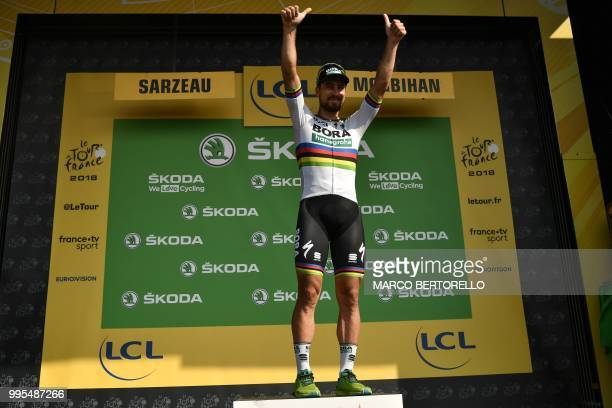 Best sprinter Slovakia's Peter Sagan waves from the podium after the fourth stage of the 105th edition of the Tour de France cycling race between La...