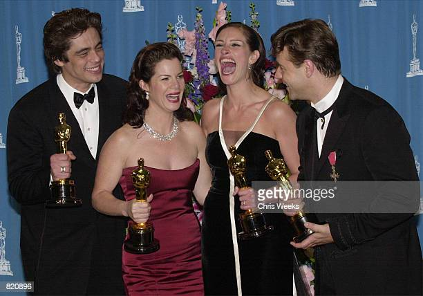 Best Supporting Actor Benicio Del Toro left Best Supporting Actress Marcia Gay Harden Best Actress Julia Roberts and Best Actor Russell Crowe pose...