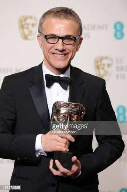 Best Supporting Actor Christoph Waltz poses in the press room at the EE British Academy Film Awards at The Royal Opera House on February 10, 2013 in...