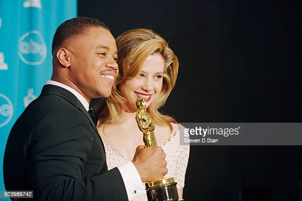 Best Supporting actor Cuba Gooding Jr holds the Oscar he won at the 69th annual Academy Awards for his role in Jerry Maguire with presenter Mira...