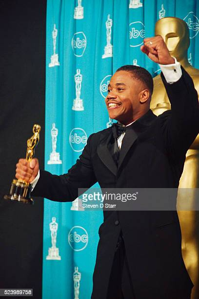 Best Supporting actor Cuba Gooding, Jr. Holds the Oscar he won for his role in Jerry Maguire.