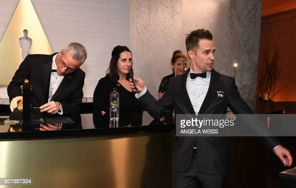 Best Supporting Actor laureate Sam Rockwell stands by the engraving station as he attends the 90th Annual Academy Awards Governors Ball at the...