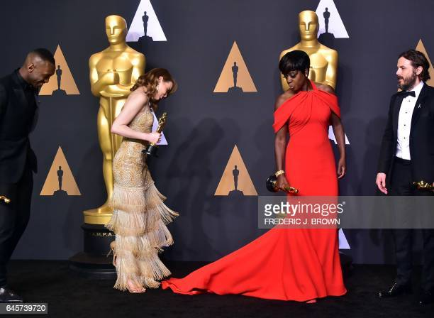 TOPSHOT Best Supporting Actor Mahershala Ali Best Actress Emma Stone Best Supporting Actress Viola Dvis and Best Actor Casey Affleck pose in the...