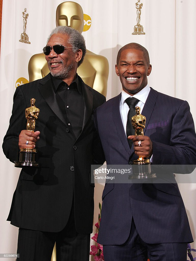 Best supporting actor Morgan Freeman and best actor Jamie Foxx pose backstage with their Oscar awards during the 77th Annual Academy Awards on February 27, 2005 at the Kodak Theater in Hollywood, California.