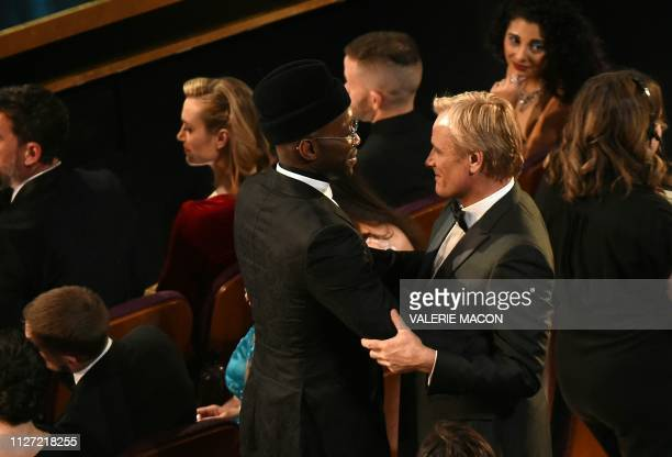 TOPSHOT Best Supporting Actor winner for Green Book Mahershala Ali embraces his film partner Viggo Mortensen during the 91st Annual Academy Awards at...