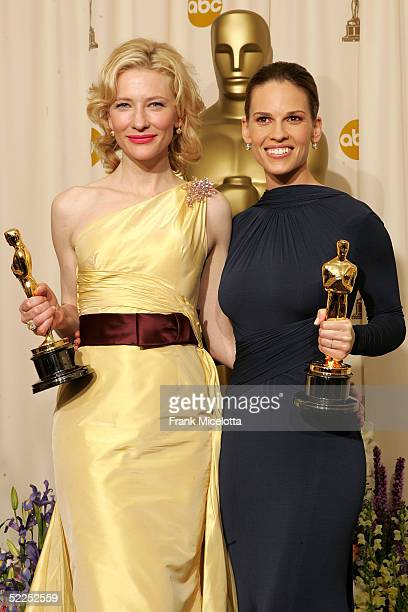 Best supporting actress Cate Blanchett and best actress Hilary Swank pose backstage with their Oscar awards during the 77th Annual Academy Awards on...