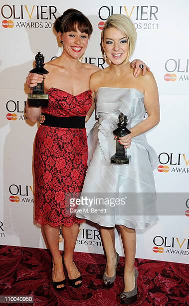 Best Supporting Actress in a Musical winner Jill Halfpenny and Best Actress in a Musical winner Sheridan Smith pose in the winner's room during the...