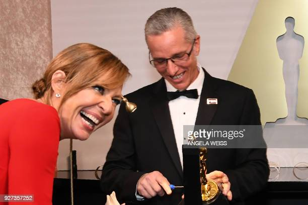 Best Supporting Actress laureate Allison Janney stands by the engraving station as she attends the 90th Annual Academy Awards Governors Ball at the...