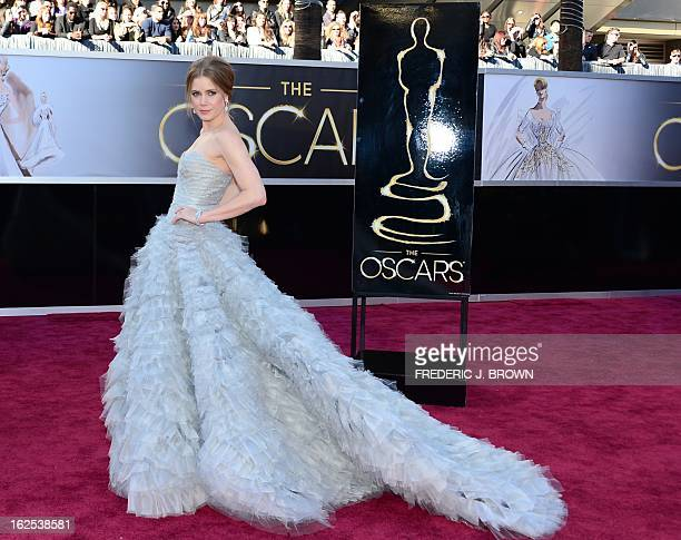 Best Supporting Actress nominee Amy Adams arrives on the red carpet for the 85th Annual Academy Awards on February 24 2013 in Hollywood California...
