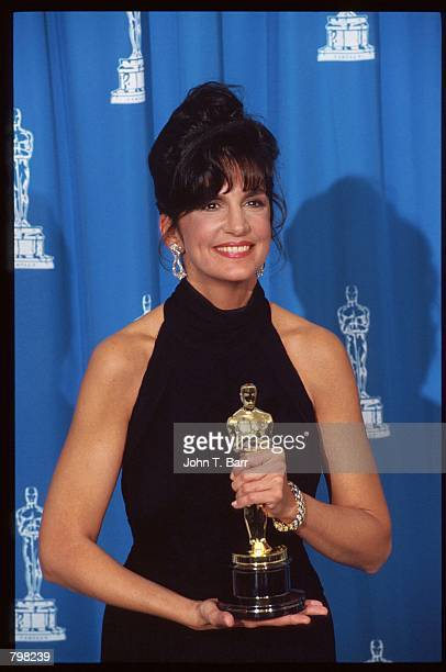 Best Supporting Actress recipient Mercedes Ruehl holds her Oscar at the 64th annual Academy Awards March 30 1992 in Los Angeles CA The Academy of...