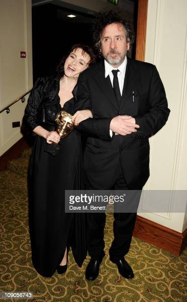 Best Supporting Actress winner Helena Bonham Carter and Director Tim Burton arrive at the dinner following the Orange British Academy Film Awards at...