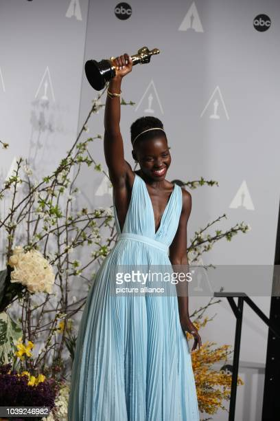 Best supporting actress winner Lupita Nyong'o poses in the press room of the 86th Academy Awards aka Oscars at Dolby Theatre in Los Angeles USA 02...
