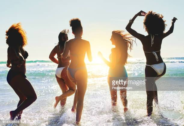 best thing about summer? beach and best friends - light skin black woman stock photos and pictures