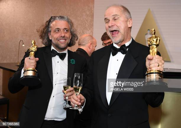 Best Visual Effects laureates John Nelson and Paul Lambert attend the 90th Annual Academy Awards Governors Ball at the Hollywood Highland Center on...