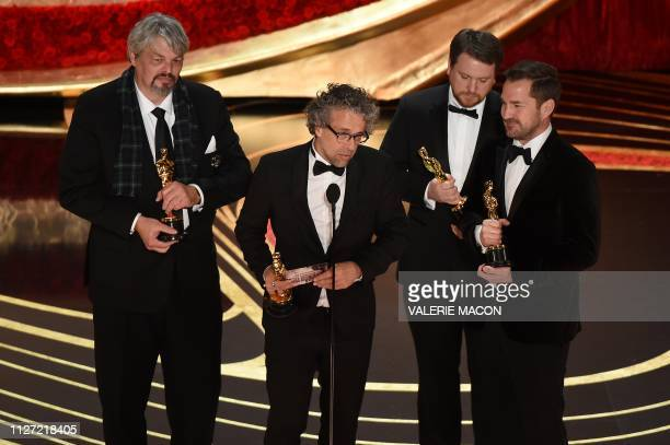 Best Visual Effects nominees for First Man Paul Lambert Ian Hunter Tristan Myles and JD Schwalm accept the award for Best Visual Effects during the...