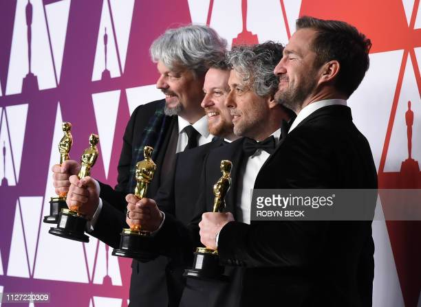 Best Visual Effects winners for First Man Ian Hunter Paul Lambert Tristan Myles and JD Schwalm pose in the press room with their Oscars during the...