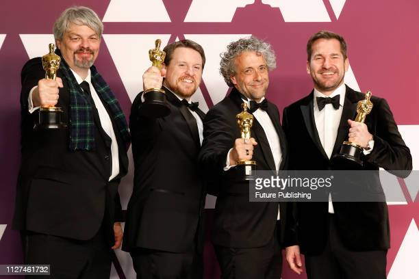 Best Visual Effects winners for 'First Man' Ian Hunter Paul Lambert Tristan Myles and JD Schwalm pose in the press room at the 91st Annual Academy...