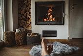 woman feet near fireplace