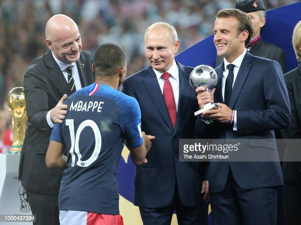 Best Young Player winner Kylian Mbappe of France is congratulated by FIFA President Gianni Infantino Russian President Vladimir Putin and French...