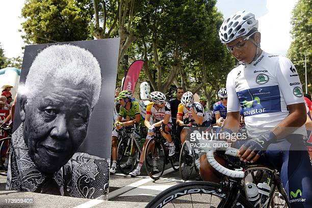Best young's white jersey Colombia's Nairo Quintana is seen as a portrait of Nelson Mandela is displayed in front of cyclists at the kilometer zero...