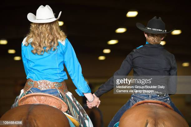 Best1 Hands are held as Boulder County Fair Lady in Waiting Ashley Doolittle is remembered during the senior ceremony of the 4H/FFA Horse Show Sunday...