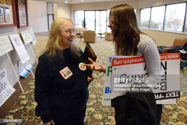 Best2 Kaye Fissinger, left, of Our Health Our Future Our Longmont, talks with Lisa Trope, of Food and Water Watch, Monday, Nov. 10, 2014 at The Plaza...