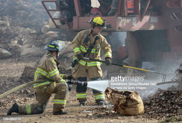 Best2 Longmont Fire Department firefighter/paramedic Ethan Unwin left and lieutenant John Weaver douse hot spots after a fire in a shredder at the...