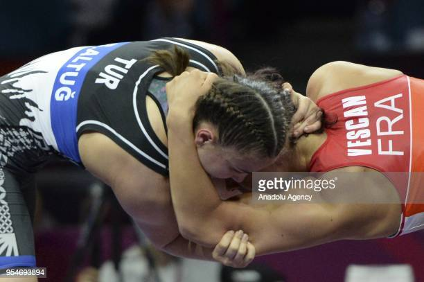 Beste Altug of Turkey competes with Cynthia Vanessa Vescan of France during the women's 72kg category match within the 2018 European Wrestling...