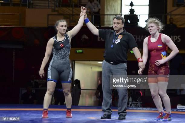 Beste Altug of Turkey reacts after 2018 European Wrestling Championships, 72 kg category quarter-final match against Anna Tislichenko in Dagestan,...