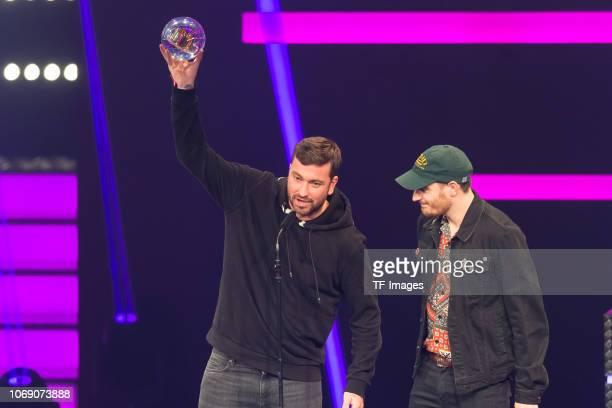 'Bestes Album' award winner Marteria and Casper speak on stage at 1Live Krone radio award at Jahrhunderthalle on December 6 2018 in Bochum Germany