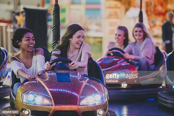 bestfriends driving dodgems - traveling carnival stock pictures, royalty-free photos & images