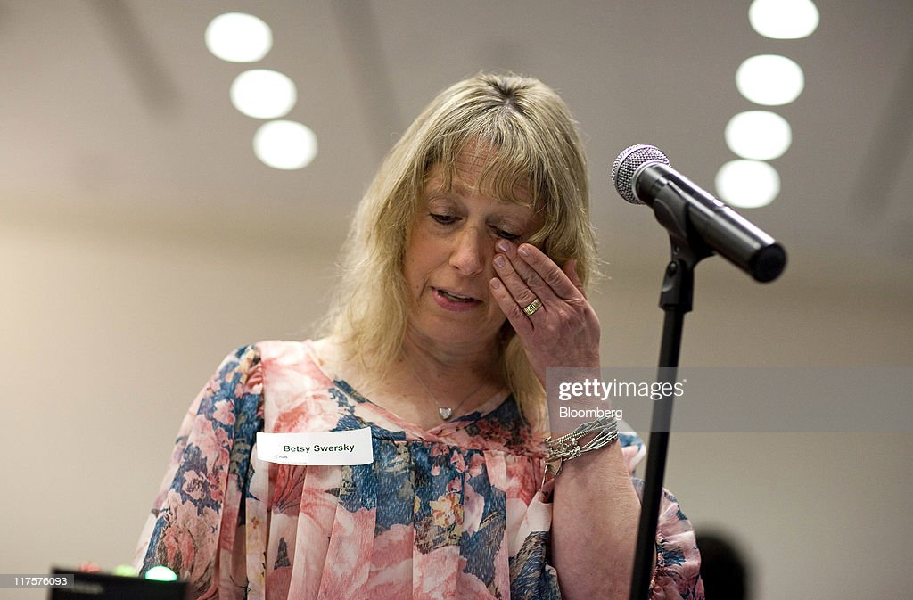 Besty Swersky, a breast cancer patient, wipes her eye while testifying in favor of Avastin during a Food and Drug Administration (FDA) hearing in Silver Spring, Maryland, U.S., on Tuesday, June 28, 2011. Breast-cancer patients and their families urged U.S. regulators to back down from a plan to withdraw approval for Roche Holding AG's Avastin, saying the treatment offered significant benefits for some women. Photographer: Joshua Roberts/Bloomberg via Getty Images