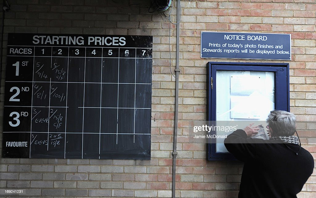 A bet is placed during racing at Huntingdon race course on May 22, 2013 in Huntingdon, England.