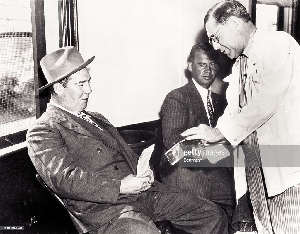Art Rooney and Swifty Morgan Exchanging Racing Information : News Photo