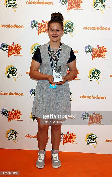 Beth age 14 from Essex poses with her Best Biker award at the Nickelodeon Fruit Shoot Skills Awards 2013 at the IndigoO2 on September 7 2013 in...