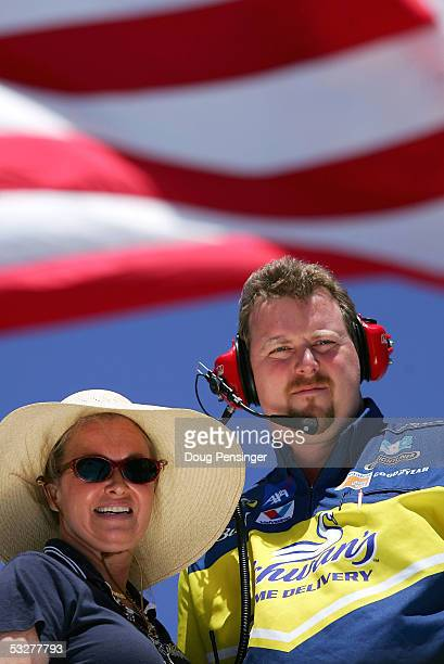 Beth Ann Morgenthau, owner of the Schwan's Home Service Dodge, watches the action from the roof of their hauler with crew chief David Hyder, during...