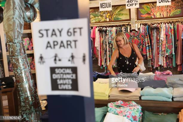 Beth Beall shops at the Tommy Bahamas store as the state of Florida enters phase one of the plan to reopen the state on May 04 2020 in Stuart Florida...