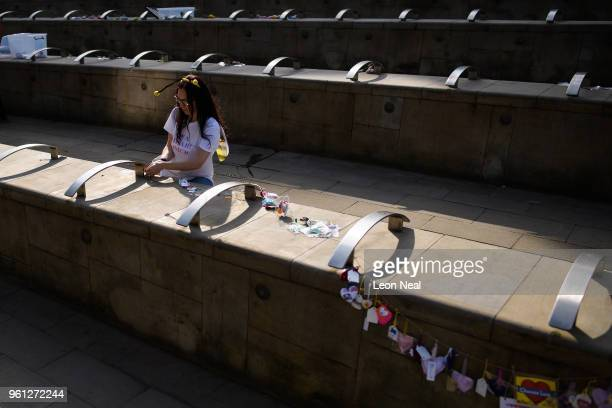 Beth Clarke hangs a string of some of the 27000 handmade hearts that have been donated to her #aheart4mcr Twitter campaign on the morning of the...