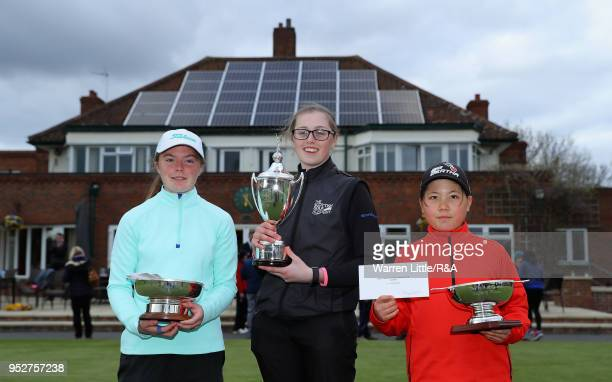 Beth Coulter Hannah Darling and Rosie Bee Kim pose with their respective trophies after the final round of the Girls' U16 Open Championship at...