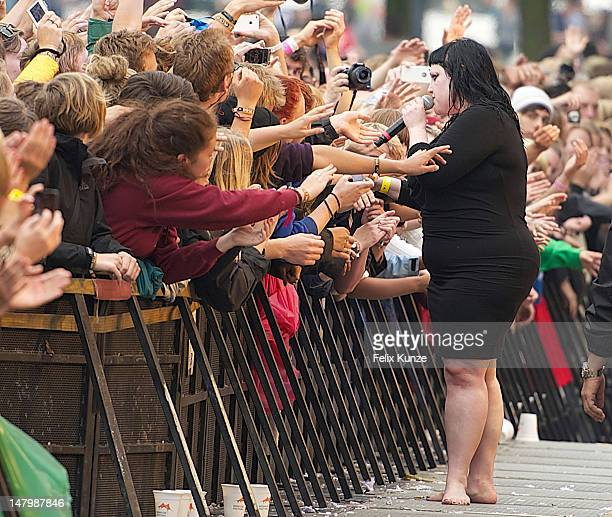 Beth Ditto of The Gossip mingles with the crowd while performing during Day 2 of the 2012 Roskilde Festival on July 6 2012 in Roskilde Denmark