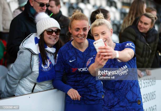 Beth England and Sophie Ingle of Chelsea have a selfie with a fan after the Barclays FA Women's Super League match between Arsenal and Chelsea at...