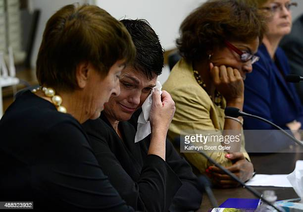 Beth Ferrier of Denver wipes away a tear as she listens to testimony from other women who describe being victims of sexual assault Ferrier along with...