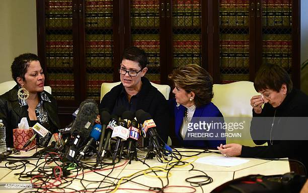 Beth Ferrier speaks of her experience with Bill Cosby while seated beside women's rights attorney Gloria Allred Chelan and a grieving helen Hayes at...