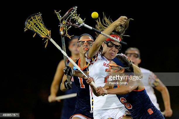 Beth Glaros of the Maryland Terrapins is checked by Natalie Glanell of the Syracuse Orange in the second half during the NCAA Division I Women's...