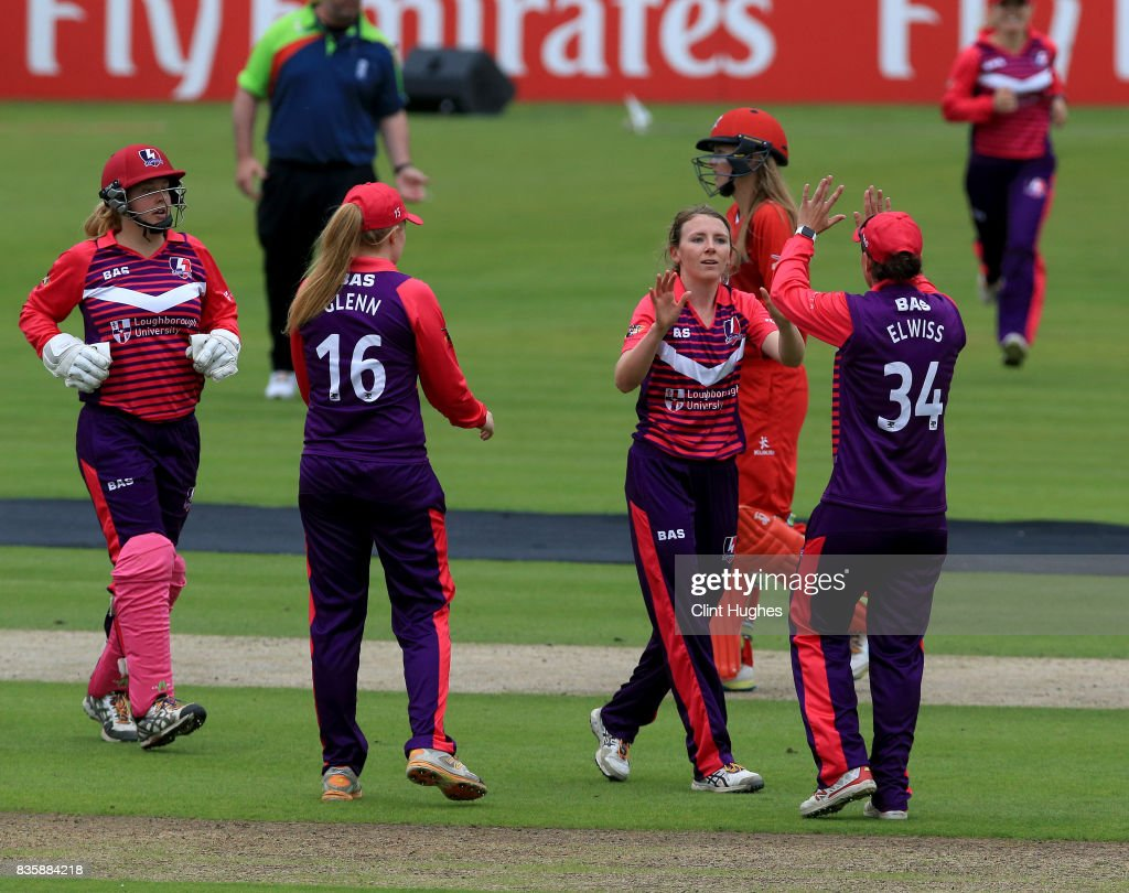 Beth Langston (2 R) of Loughborough Lightning celebrates after she takes the wicket of Sophie Ecclestone of Lancashire Thunder during the Kia Super League match between Lancashire Thunder and Loughborough Lightning at Blackpool Cricket Club on August 20, 2017 in Blackpool, England.